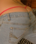 Blonde teen Marylin shows off her tight round ass in tight jeans with her g-string peaking out