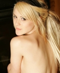 Petite blonde Haley loves teasing as she strips out of her scarf and black panties