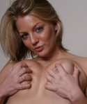 Sadie squeezes her huge D cup tits together